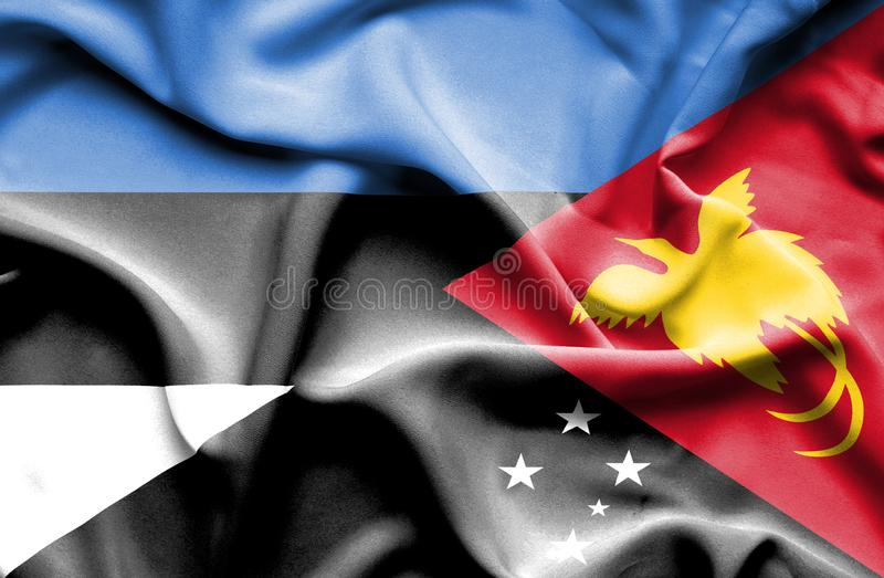Waving flag of Papua New Guinea and Estonia stock photos