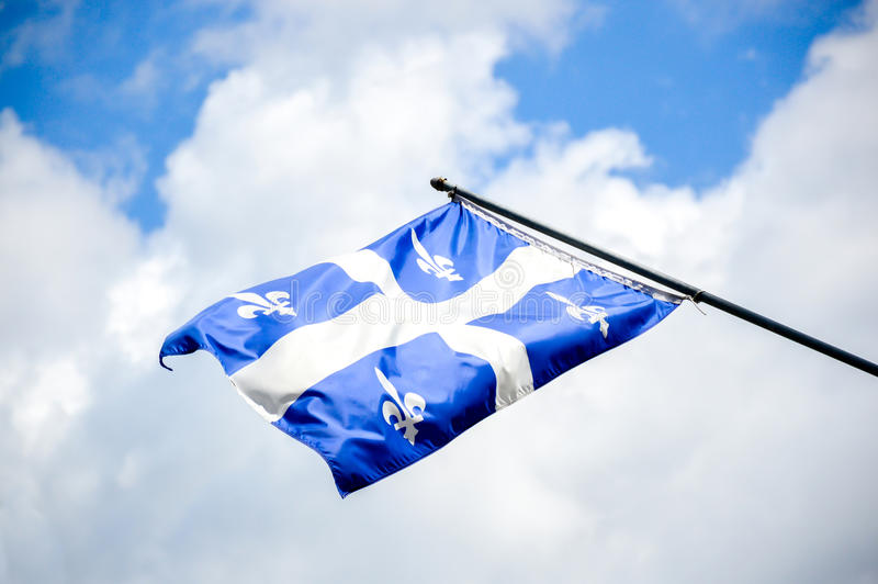 The waving flag of Quebec royalty free stock image