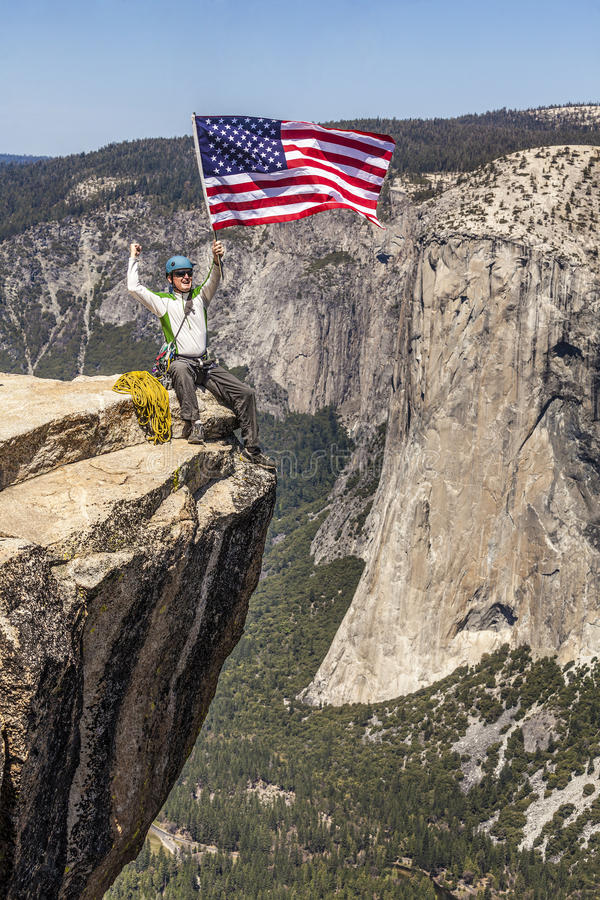 Download Waving A Flag On The Summit. Stock Image - Image: 24724747