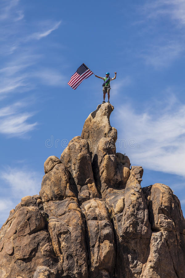 Waving A Flag On The Summit. Stock Photography