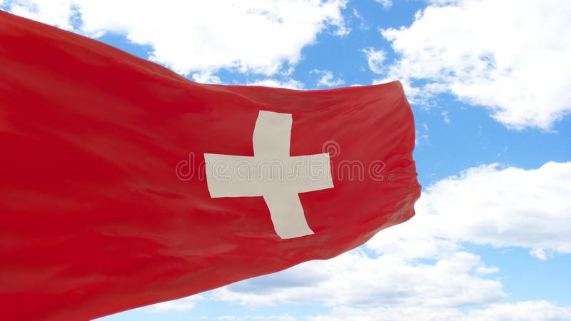 Waving flag of Switzerland on blue cloudy sky. royalty free stock photo