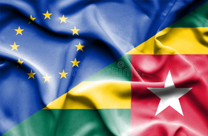 Waving flag of Togo and EU. Waving flag of Togo and royalty free stock photography