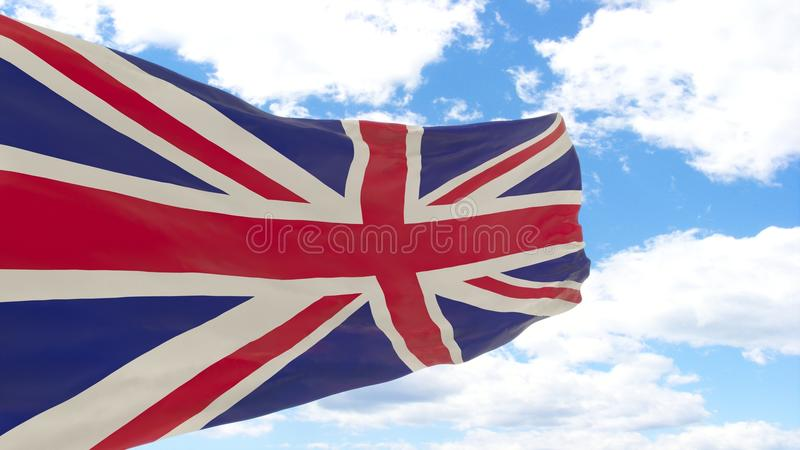 Waving flag of United Kingdom on blue cloudy sky. royalty free stock images