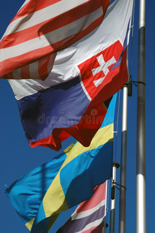 Waving flags royalty free stock photos