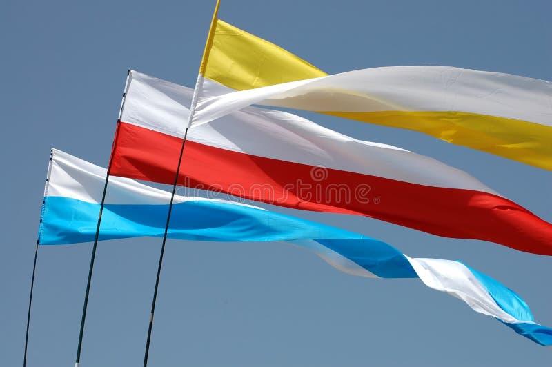 Waving flags royalty free stock photos