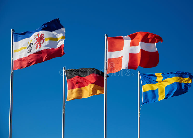 waving flags of baltic royalty free stock photo