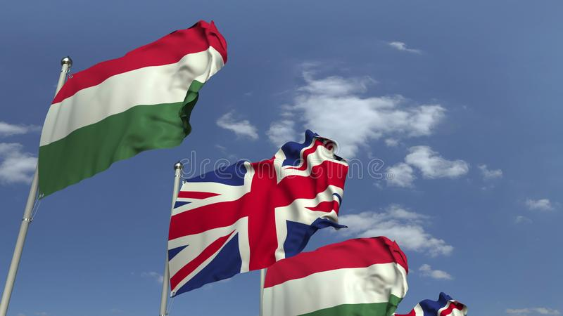Row of waving flags of Hungary and the United Kingdom, 3D rendering. Waving flags of countries against sky, 3D stock illustration