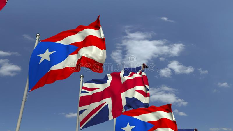 Waving flags of Puerto Rico and the United Kingdom, 3D rendering. Waving flags of countries against sky, 3D royalty free illustration