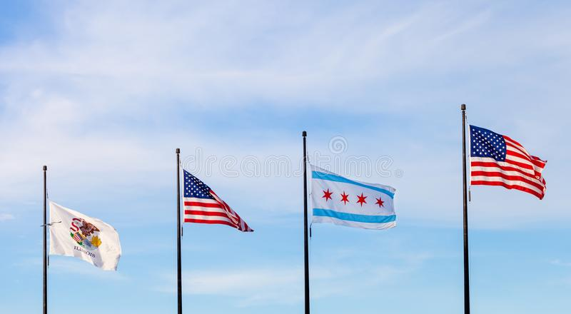 Waving flags of the state of Illinois, the United States and of. The city of Chicago with sky in the background stock photography
