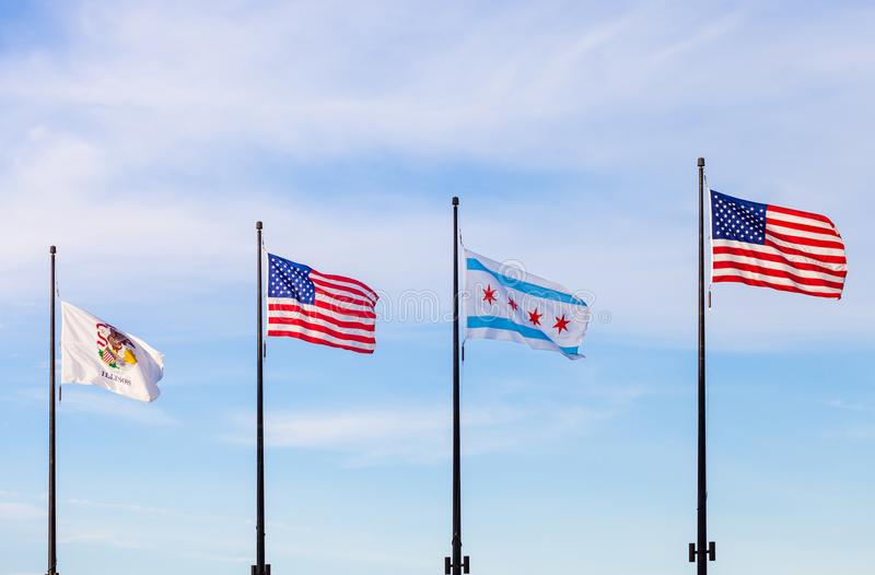 Waving flags of the state of Illinois, the United States and of. The city of Chicago with sky in the background stock photo