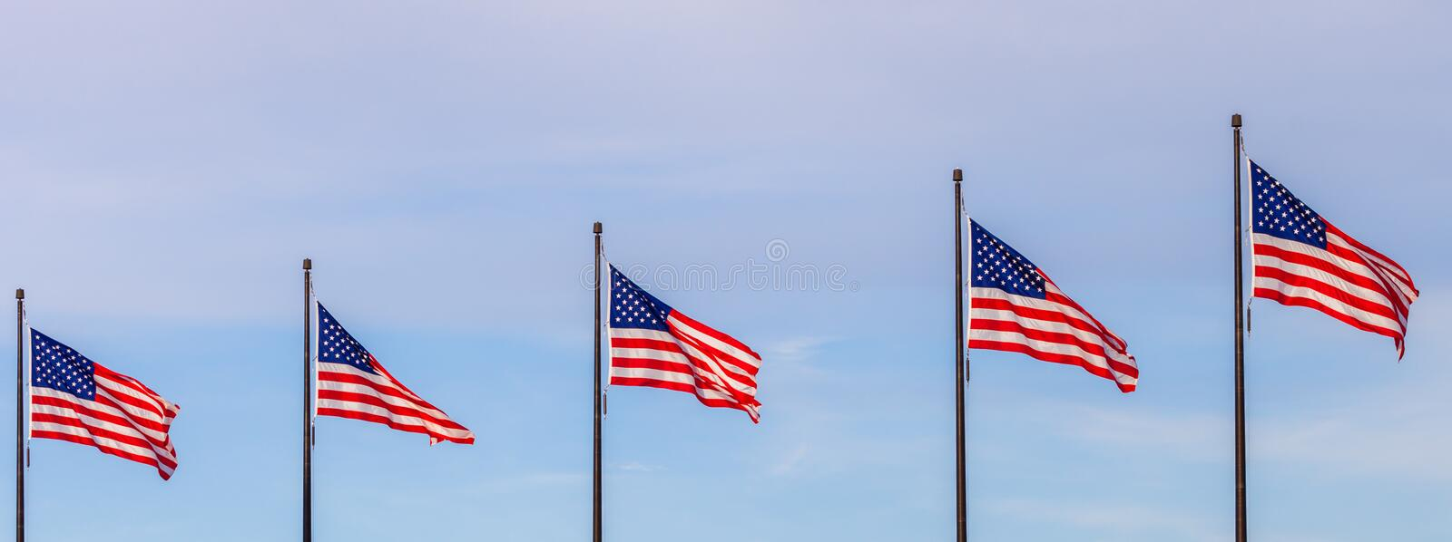 Waving flags of the United States on the Pier in Chicago with sk. Y in the background stock photography
