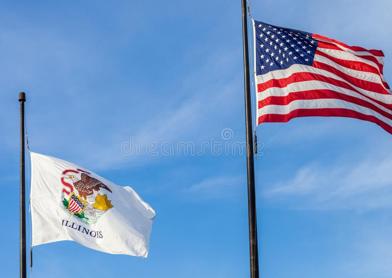 Waving flags of the United States and the state of Illinois with. Sky in the background royalty free stock photography