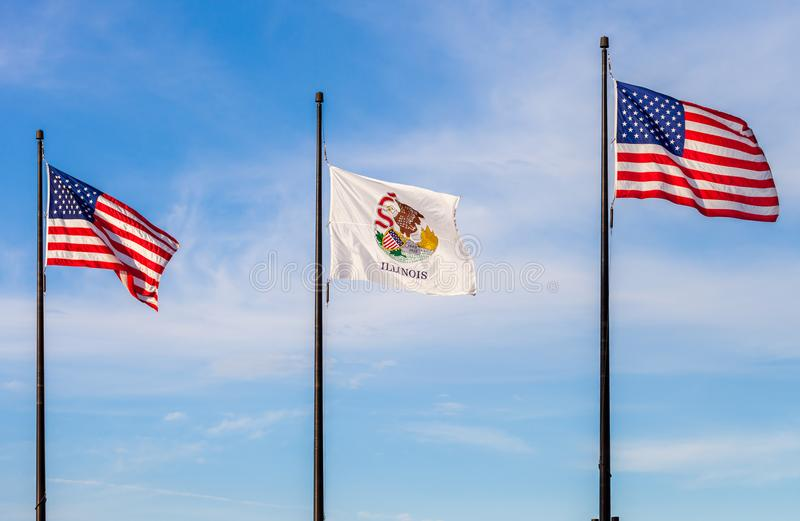 Waving flags of the United States and the state of Illinois with. Sky in the background stock photography