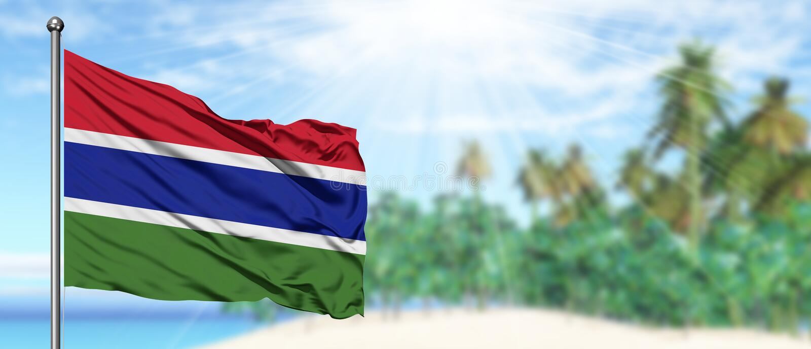 Waving Gambia flag in the sunny blue sky with summer beach background. Vacation theme, holiday concept stock photography