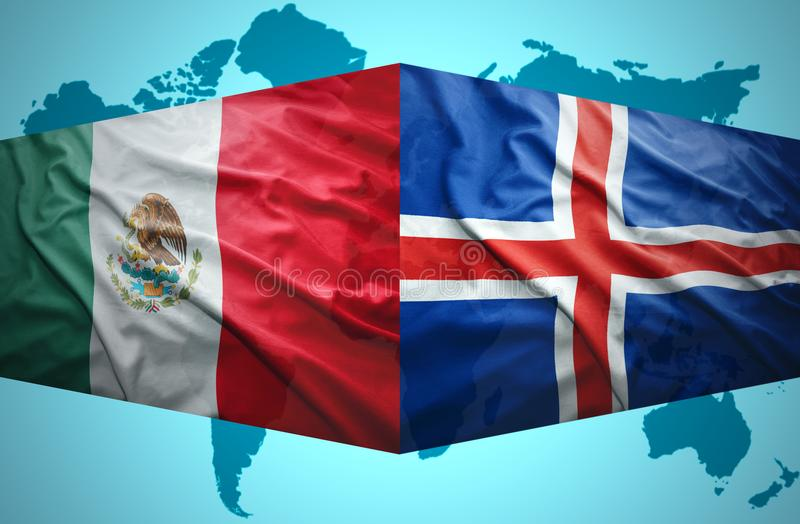 Waving Icelandic and Mexican flags. Of the political map of the world stock photo