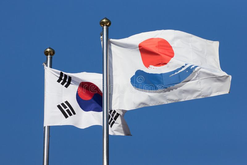 A Waving korean flag with another flag. stock photos