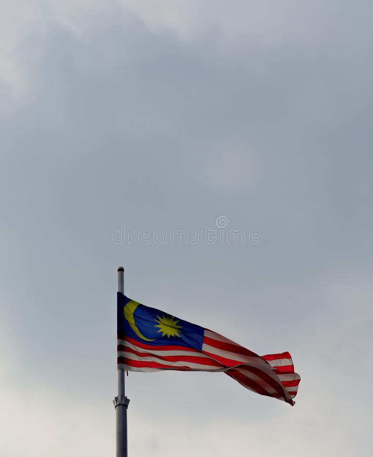 Malaysian flag waving in the blue sky royalty free stock photography