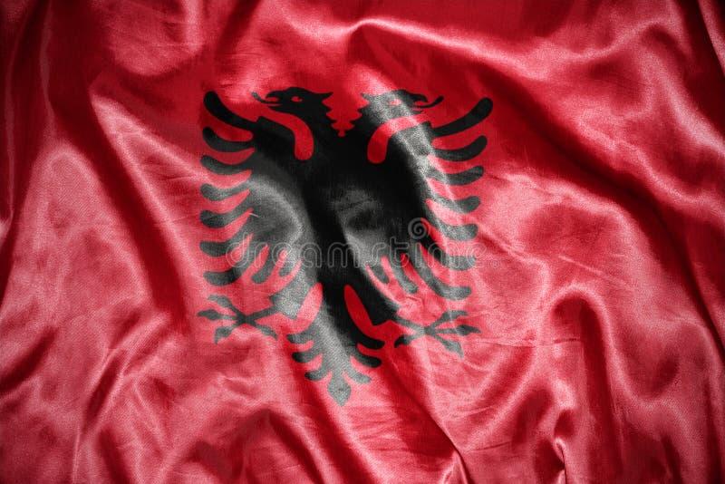 Shining albanian flag. Waving and shining albanian flag stock image