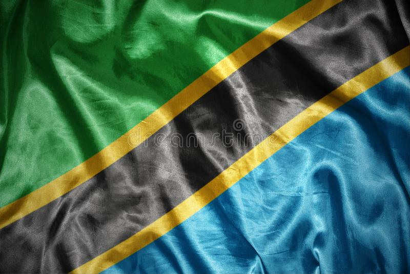 Shining tanzanian flag. Waving and shining tanzanian flag stock image