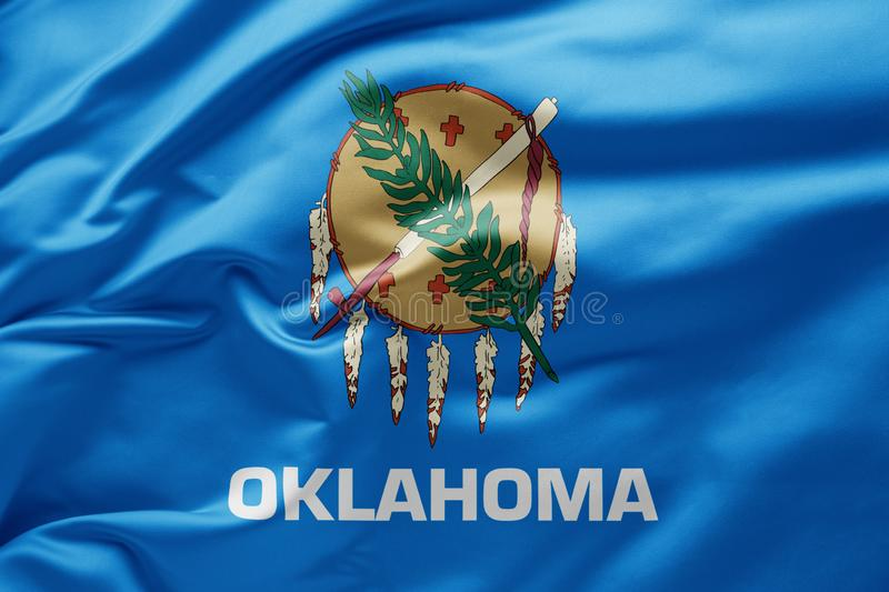 Waving state flag of Oklahoma - United States of America royalty free stock images
