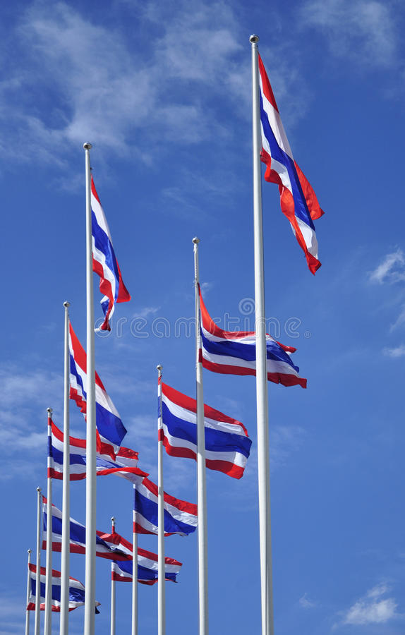 Waving Thai flags with blue sky stock images