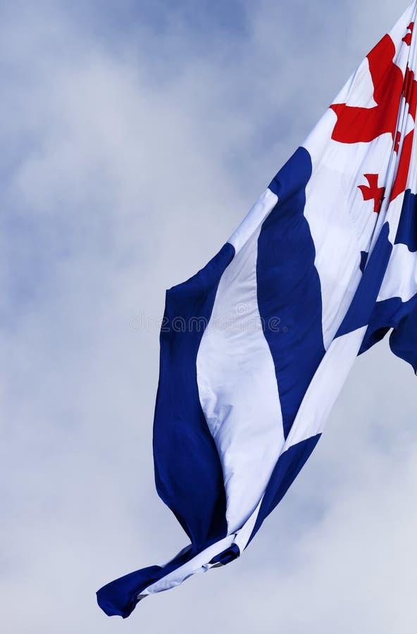 Flag of Adjara. Waving on wind flag of Adjara autonomous republic of Georgia and cloudy sky. Close-up view royalty free stock image
