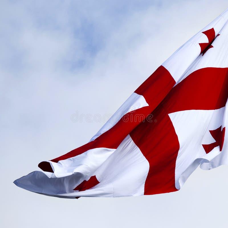 Waving on wind flag of Georgia royalty free stock photos