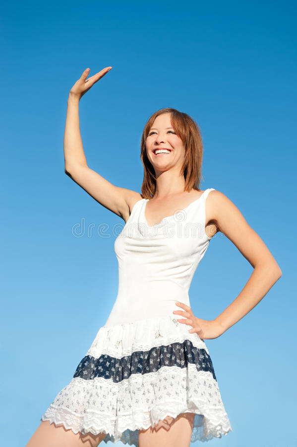 Download Waving Young Woman In Summer Dress Stock Image - Image: 20812873