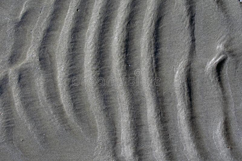 Wavy beach sand background, vertical waves royalty free stock photo