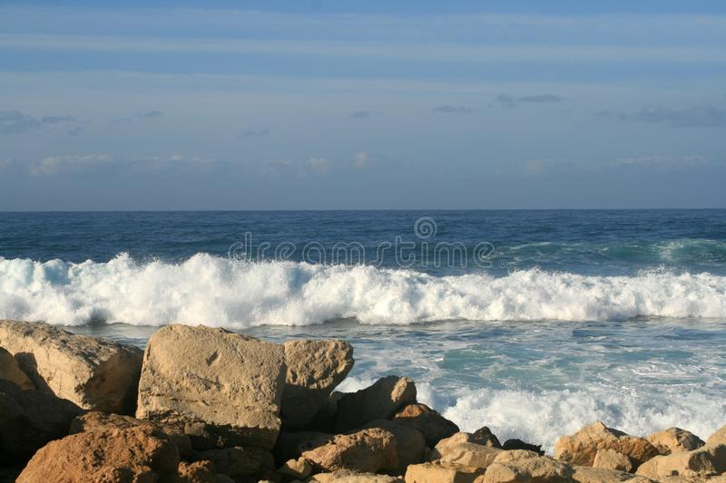 Wavy Mediterranean sea on a summer evening royalty free stock photos