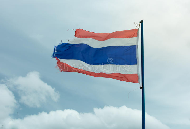 Wavy old flag of Thailand against blue sky royalty free stock photo