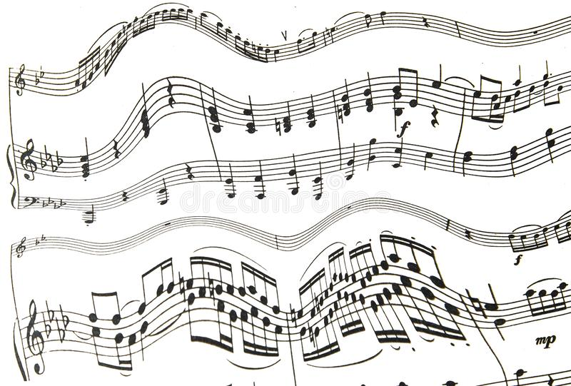 Treble and bass clef with melody notes on white background. Wavy stave with bass and treble clef and cheerful notes stock photo