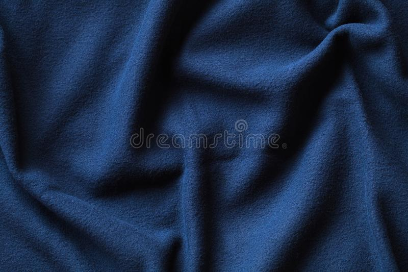 Wavy texture of blue fleece fabric royalty free stock photo