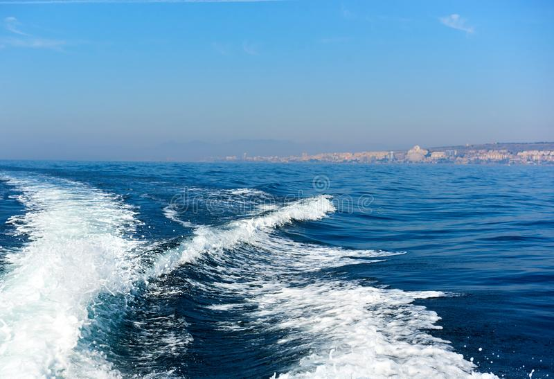 Wavy trail on the Mediterranean Sea after vessel, Spain royalty free stock photos