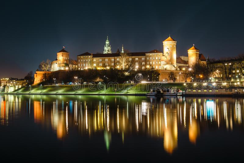 Wawel Castle as seen from another bank of Vistula. Krakow is the most famous landmark in Poland. Night view. The Royal Wawel Castle as seen from another bank of stock photography