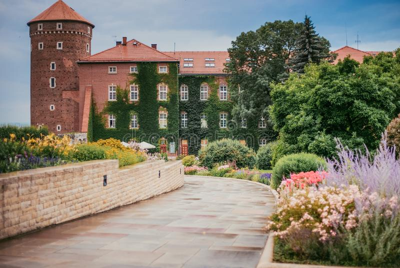 Wawel Castle and beautiful blooming flower beds. Summer vintage Wawel, blooming flowers royalty free stock photography