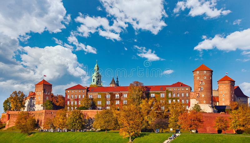 Wawel castle famous landmark in Krakow Poland. Picturesque landscape on coast river Wisla. Autumn sunset with white sky and cloud royalty free stock image