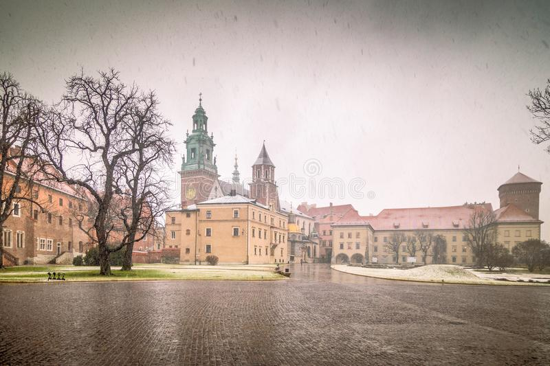 Wawel castle in Krakow during a snowy day at Christmas. stock photos
