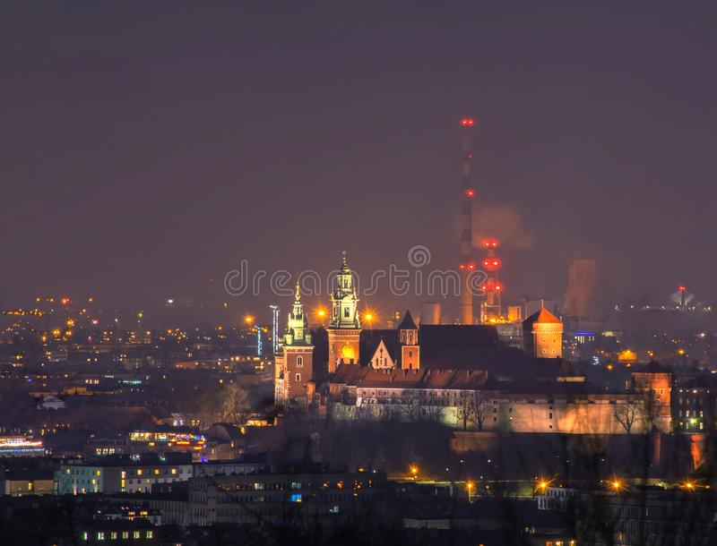 Wawel castle and power plant pipes at night, Krakow, Poland stock image