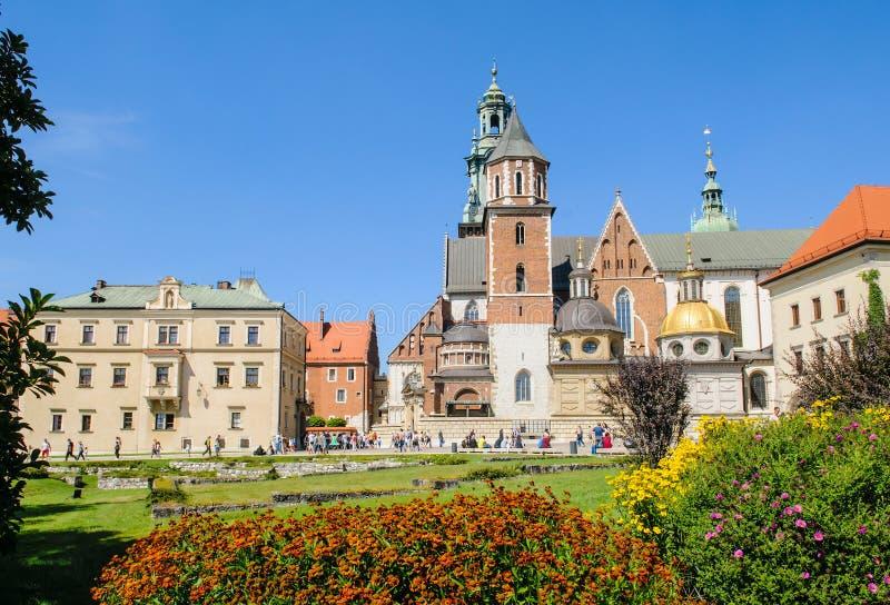 Wawel Castle square in Krakow, Poland. KRAKOW, POLAND - AUGUST 20: Tourists walk near Wawel Castle in historical center of Krakow, Poland on August 20, 2015 stock image