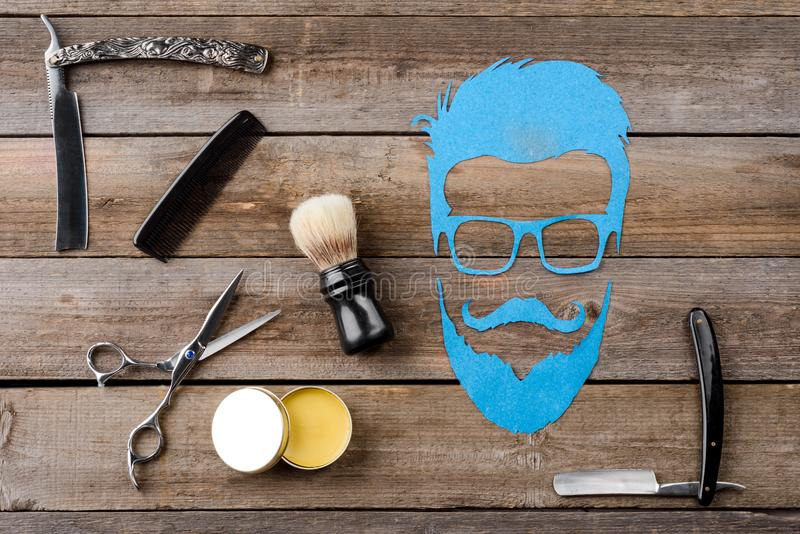 Wax, brush and face silhouette stock image