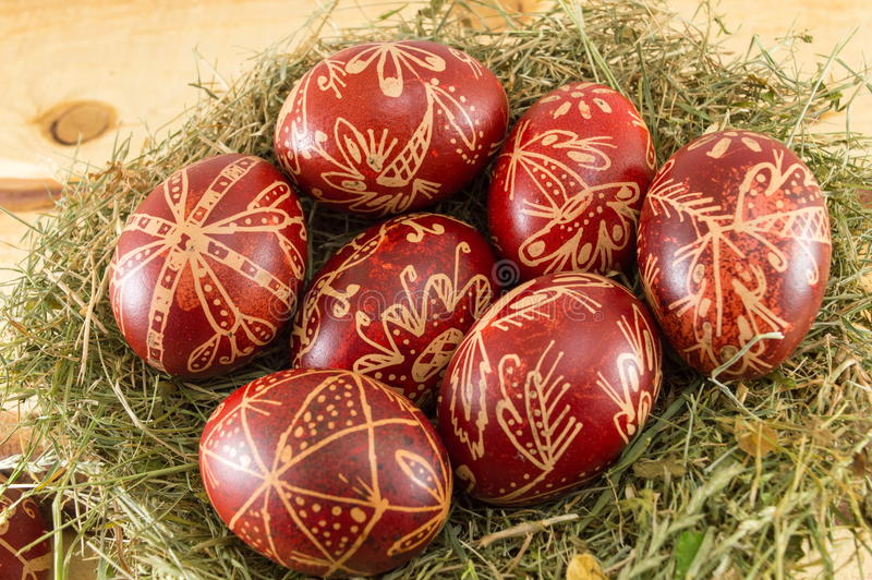 Wax painted Easter eggs. Wax painted red Easter eggs stock images