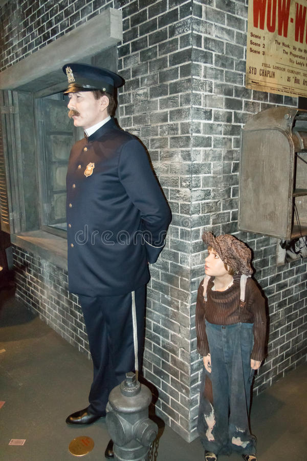Wax statues of a kid and a police officer at Charlie Chaplin's world museum in Vevey, Switzerland royalty free stock photography