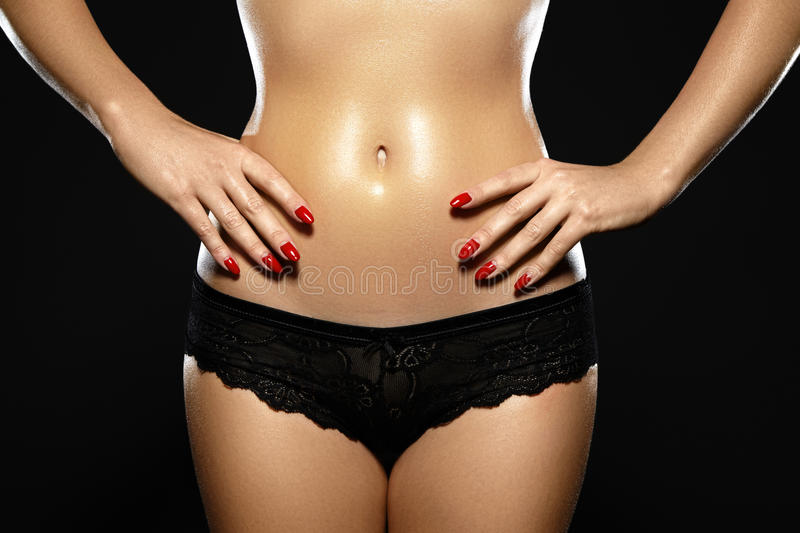 Waxing for beautiful woman. Brazilian laser hair removal bikini line an body shapes. Close-up of female wearing black la. Ce panties. Body care and clean skin stock photos