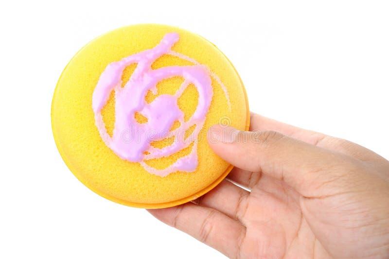 Waxing. Polish wax on applicator pad, waxing the car royalty free stock image
