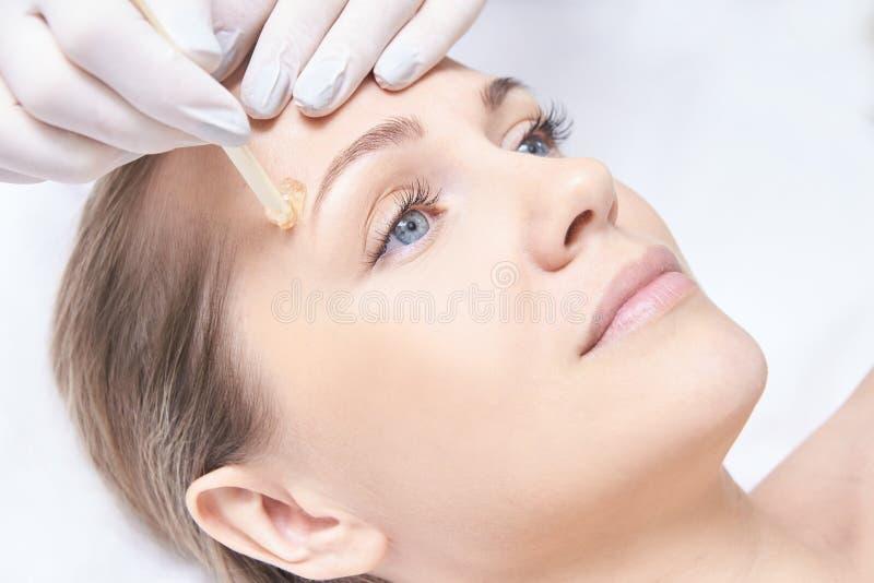 Waxing woman body. Sugar hair removal. laser service epilation. Salon wax beautician procedure. Waxing women body. Sugar hair removal. laser service epilation royalty free stock photography