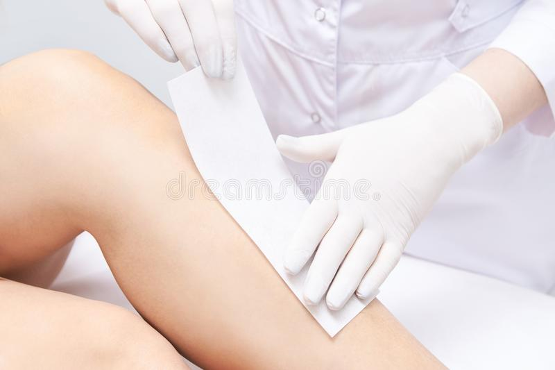 Waxing woman leg. Sugar hair removal. laser service epilation. Salon wax beautician procedure.  stock image