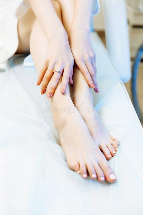 Waxing woman leg. Sugar hair removal. laser service epilation stock photos