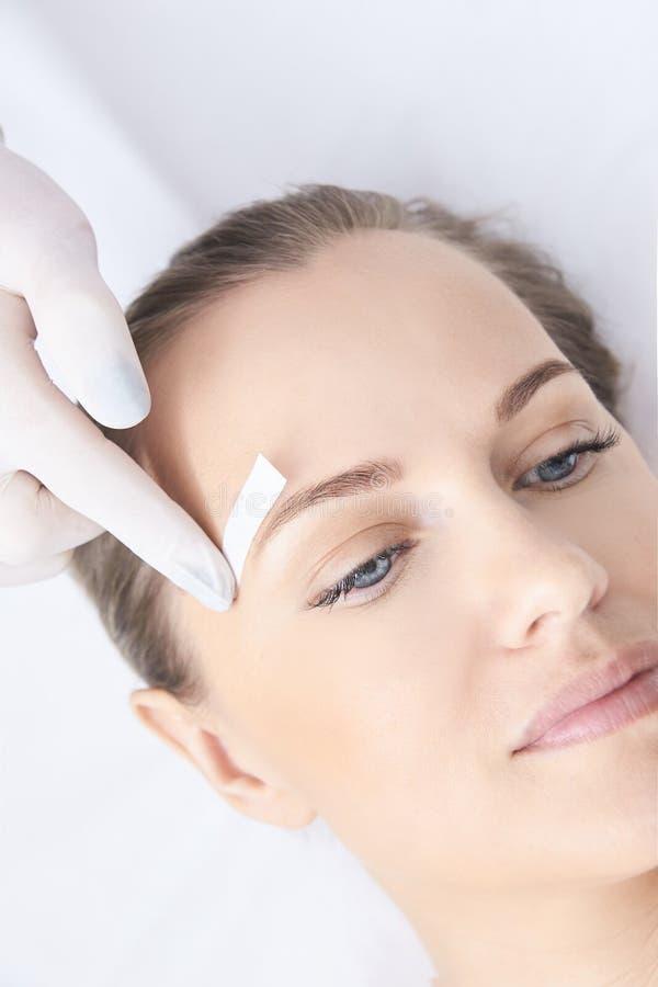 Waxing woman body. Sugar hair removal. laser service epilation. Salon wax beautician procedure. Waxing women body. Sugar hair removal. laser service epilation stock photo