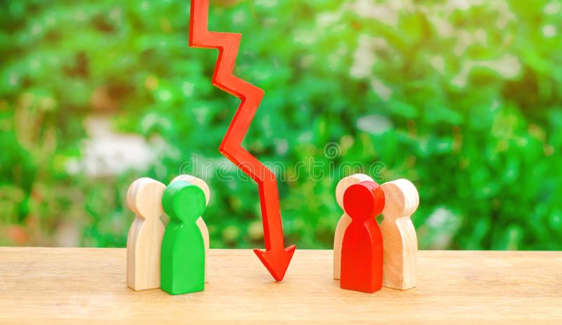 The way of the deal, humility and dialogue. Two groups of people separated by a red arrow. Concept of conflict of interest stock photo